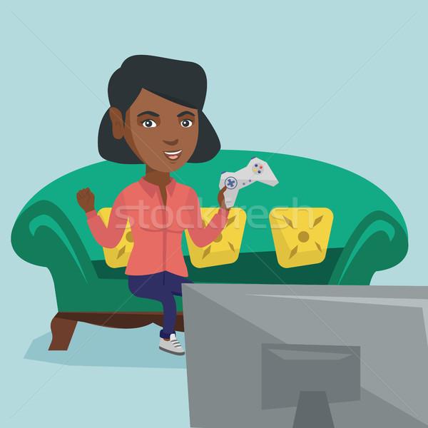 Young african-american woman playing video game. Stock photo © RAStudio