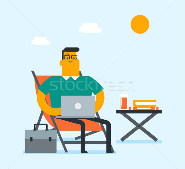 Business man working on a laptop on the beach. Stock photo © RAStudio