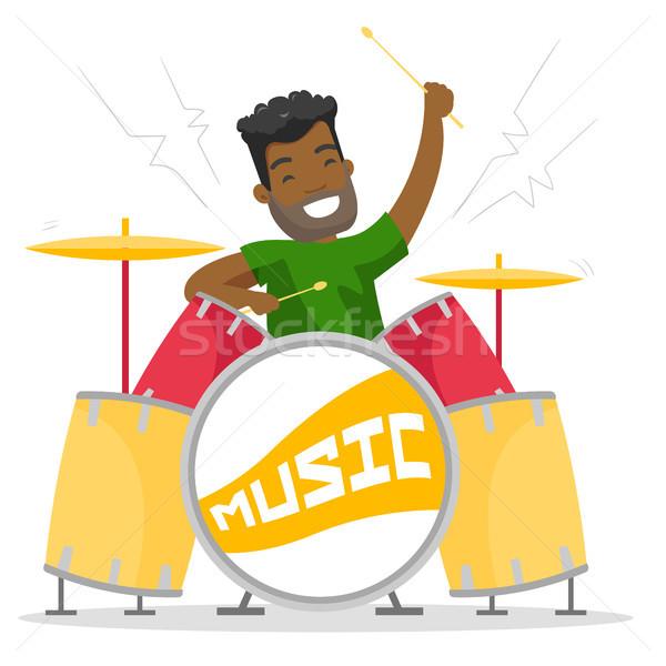 Jonge man spelen trommel uitrusting glimlachend Stockfoto © RAStudio
