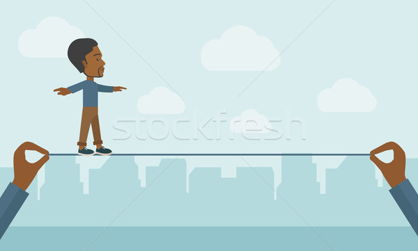 Black Businessman walking on wire. Stock photo © RAStudio