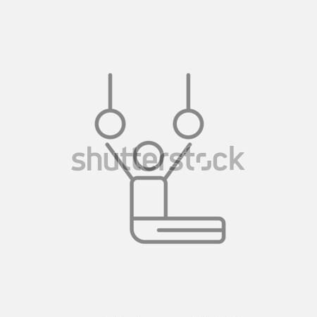 Tornász előad mozdulatlan gyűrűk vonal ikon Stock fotó © RAStudio