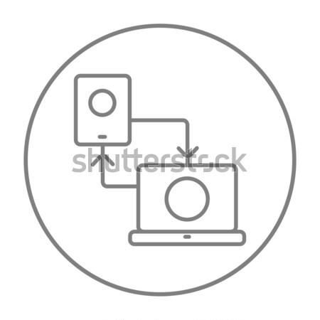 Synchronization smartphone with laptop line icon. Stock photo © RAStudio