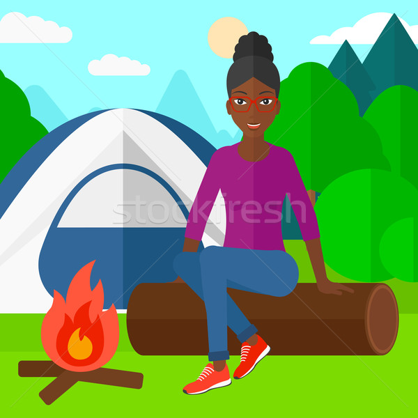 Woman sitting at camp. Stock photo © RAStudio