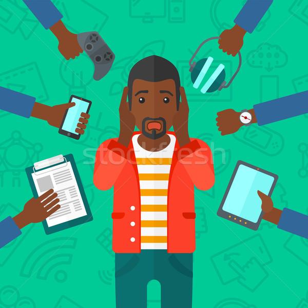 Wanhopig man gadgets wanhoop veel handen Stockfoto © RAStudio