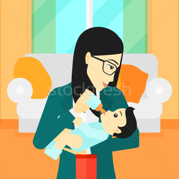 Woman feeding baby. Stock photo © RAStudio