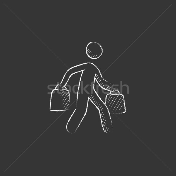 Man carrying shopping bags. Drawn in chalk icon. Stock photo © RAStudio