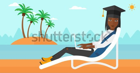 Graduate lying on chaise lounge with laptop. Stock photo © RAStudio