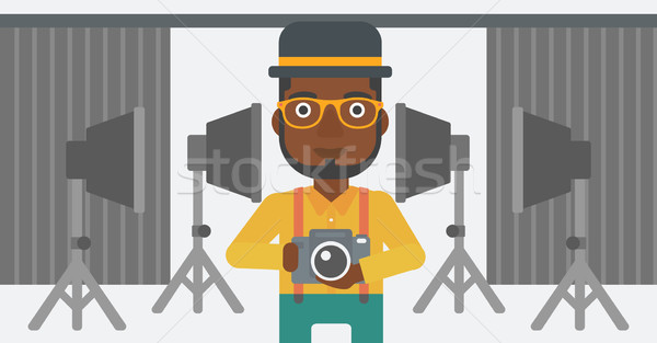 Souriant photographe caméra homme photo Photo stock © RAStudio