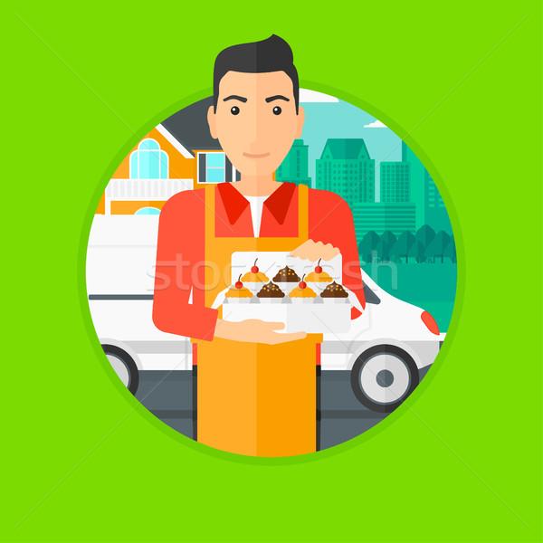 Baker delivering cakes. Stock photo © RAStudio