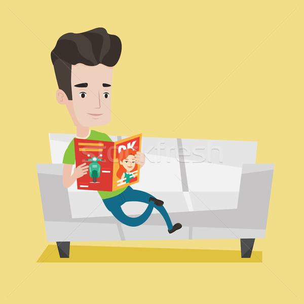 Férfi olvas magazin kanapé fiatal kaukázusi Stock fotó © RAStudio