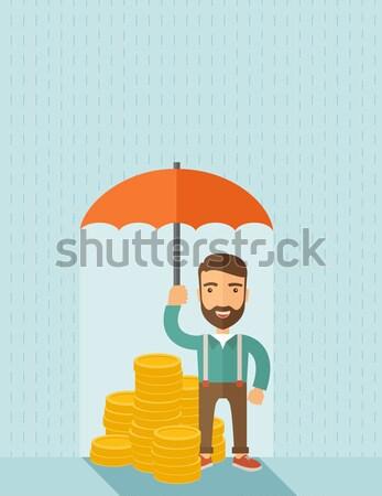 Businessman with umbrella Stock photo © RAStudio