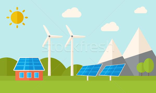 House with solar panels and wind mills. Stock photo © RAStudio