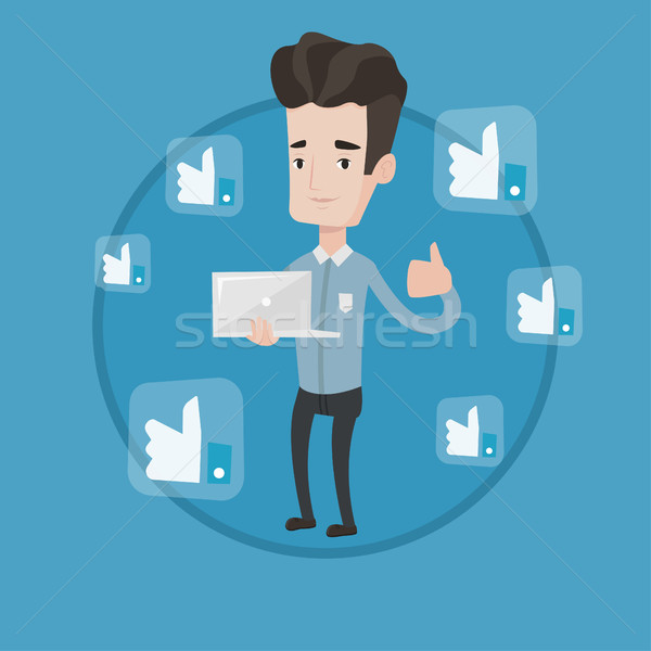 Man with thumb up and like social network buttons. Stock photo © RAStudio