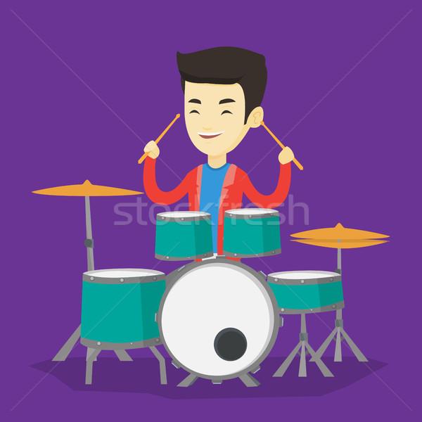 Man playing on drum kit vector illustration. Stock photo © RAStudio