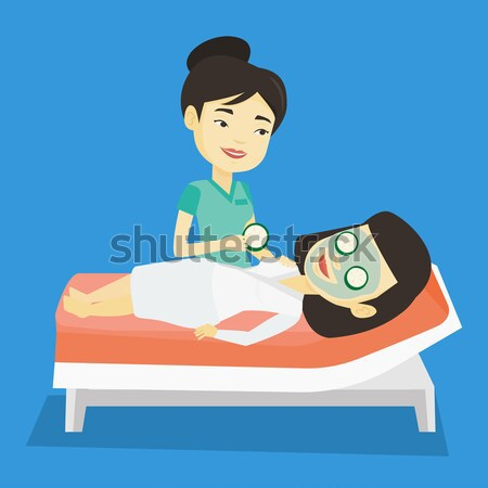 Cosmetologist making beauty treatments to woman. Stock photo © RAStudio