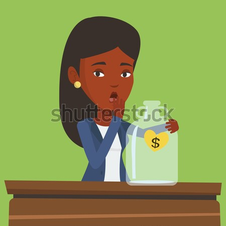 Worried businessman looking at empty money box. Stock photo © RAStudio
