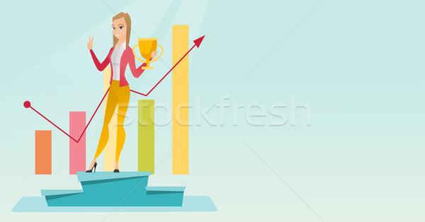 Business woman proud of her business award. Stock photo © RAStudio