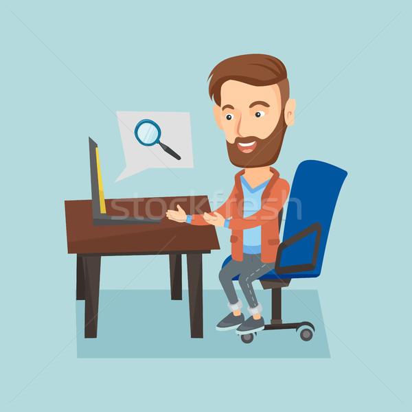 Business man working on his laptop. Stock photo © RAStudio