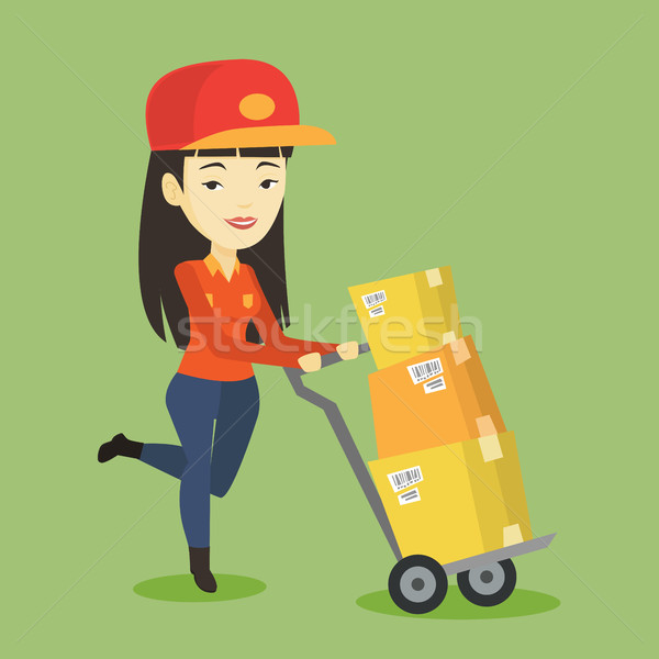 Delivery postman with cardboard boxes on trolley. Stock photo © RAStudio