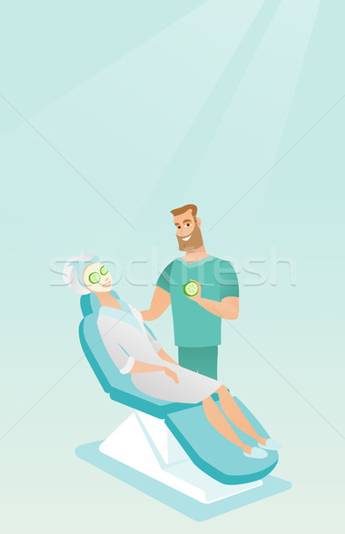 Cosmetologist making beauty treatments to a woman. Stock photo © RAStudio