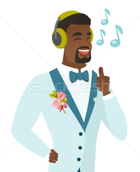 African groom listening to music in headphones. Stock photo © RAStudio