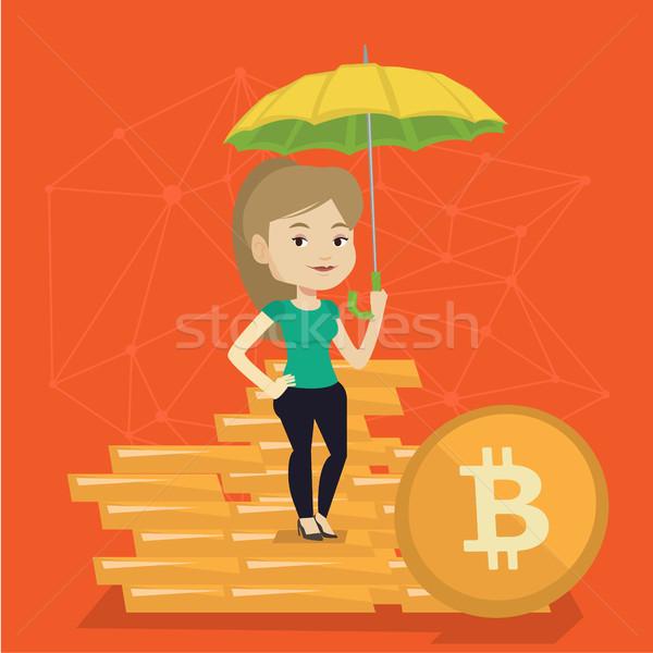 Young woman with umbrella protecting bitcoin coins Stock photo © RAStudio