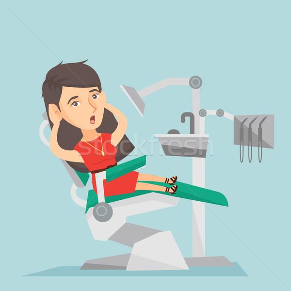 Bange vrouw vergadering tandheelkundige stoel kaukasisch Stockfoto © RAStudio