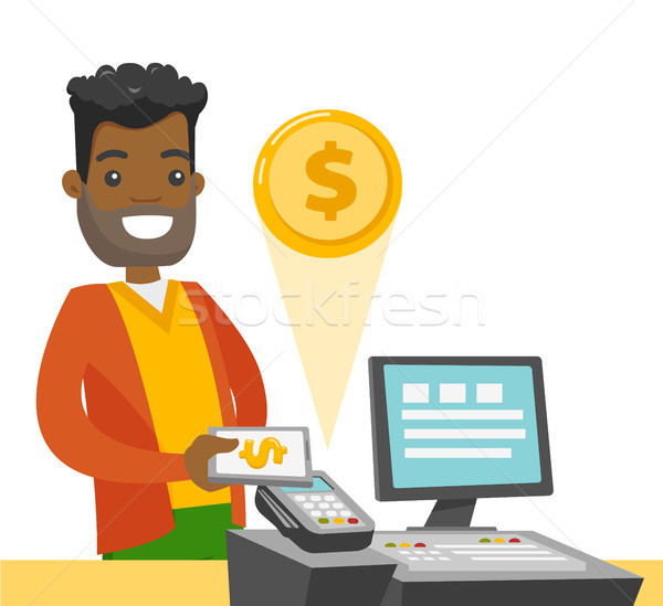 A black man paying at cashbox with his smartphone. Stock photo © RAStudio