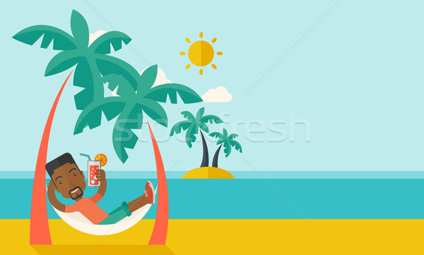 Young black man on th beach relaxing and drinking cocktail. Stock photo © RAStudio