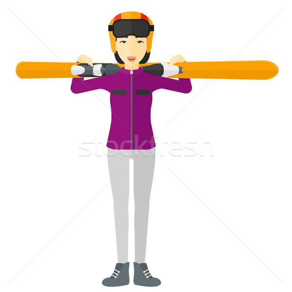 Woman holding skis. Stock photo © RAStudio