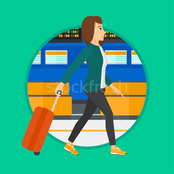 Stock photo: Woman walking with suitcase at the airport.