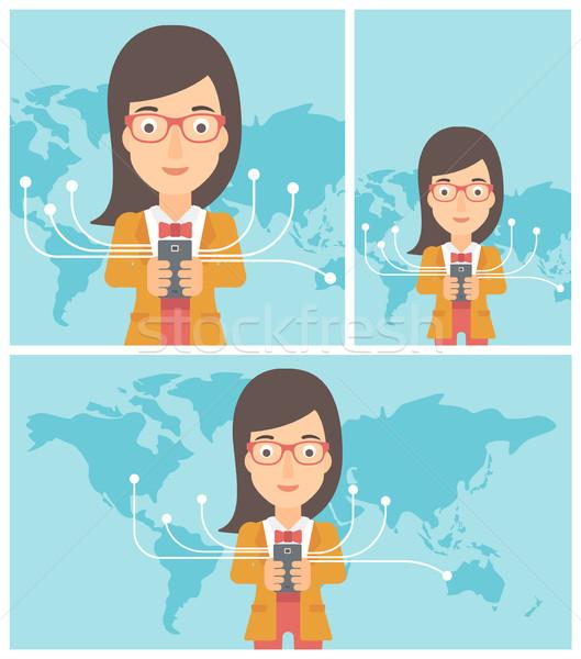 Business woman using smartphone. Foto stock © RAStudio