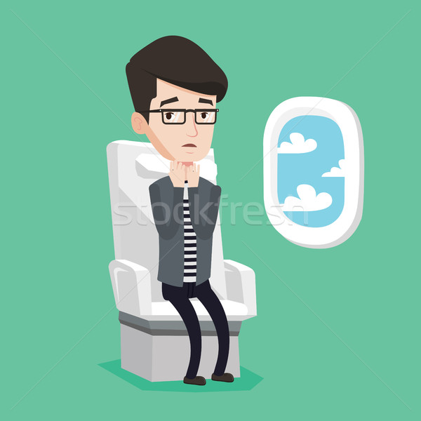 Young man suffering from fear of flying. Stock photo © RAStudio
