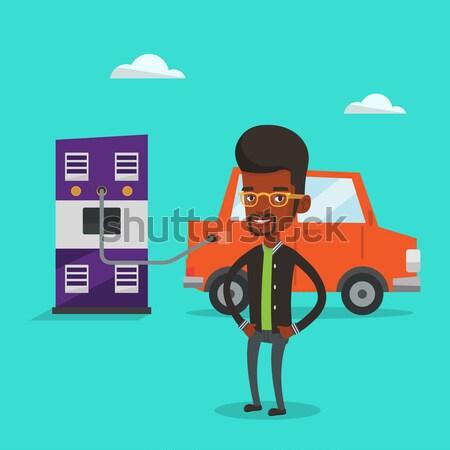 Elektrische auto jonge afrikaanse man station vrolijk Stockfoto © RAStudio