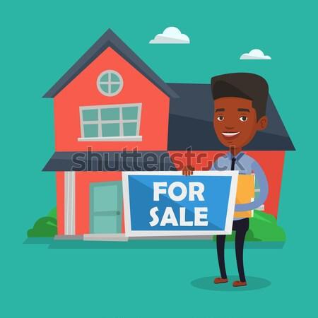 предлагающий дома африканских агент по продаже недвижимости плакат Сток-фото © RAStudio
