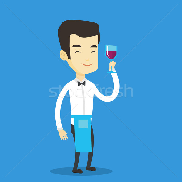 Bartender holding a glass of wine in hand. Stock photo © RAStudio
