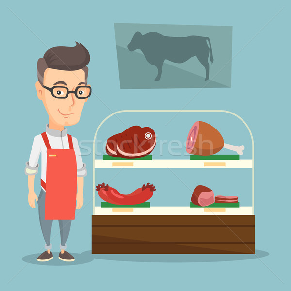 Butcher offering fresh meat in a butchershop. Stock photo © RAStudio