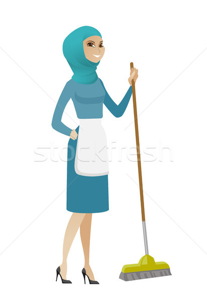 Young muslim housemaid sweeping floor with a broom Stock photo © RAStudio