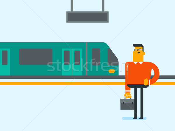 Caucasian man walking on railway station platform. Stock photo © RAStudio