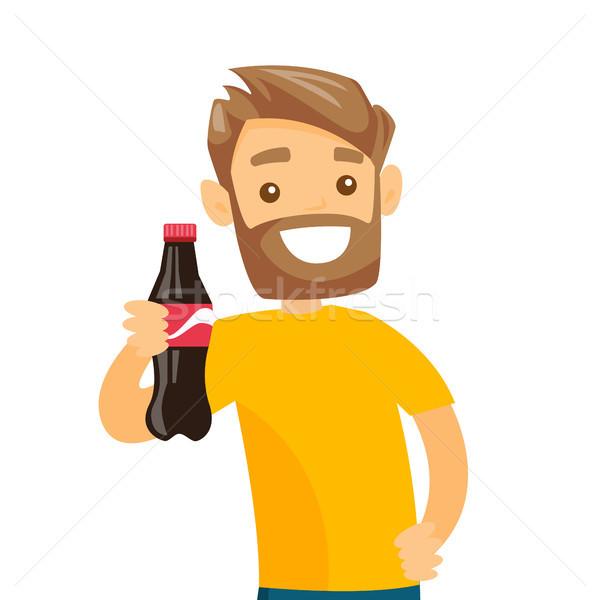 Young caucasian white man holding bottle of soda. Stock photo © RAStudio