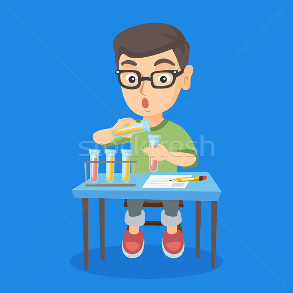 Kid conducting experiment in laboratory class. Stock photo © RAStudio