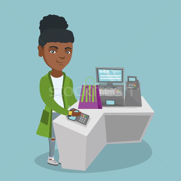 Afrikai nő fizet drótnélküli okos óra Stock fotó © RAStudio