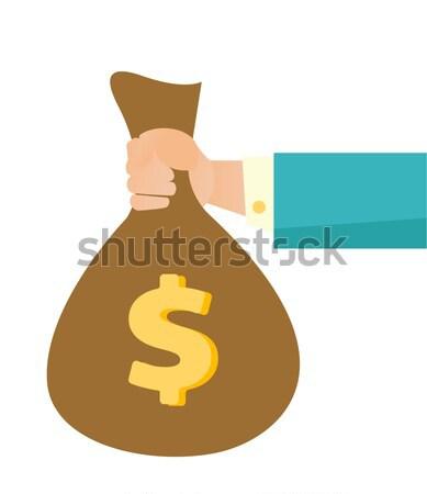 üzletember kéz tart pénz táska vektor Stock fotó © RAStudio