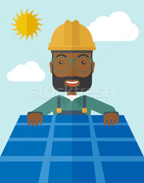 Férfi napelem tető afrikai alternatív energia Stock fotó © RAStudio