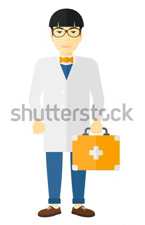 Doctor with first aid box. Stock photo © RAStudio