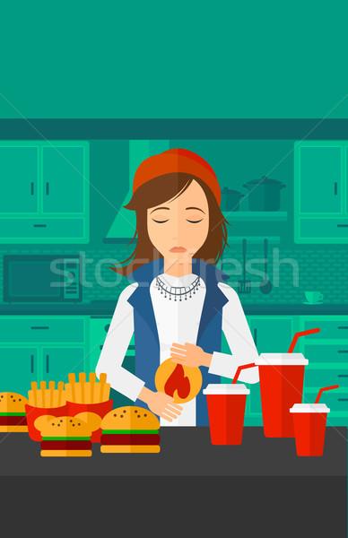 Donna sofferenza bruciore di stomaco piedi tavolo da cucina completo Foto d'archivio © RAStudio