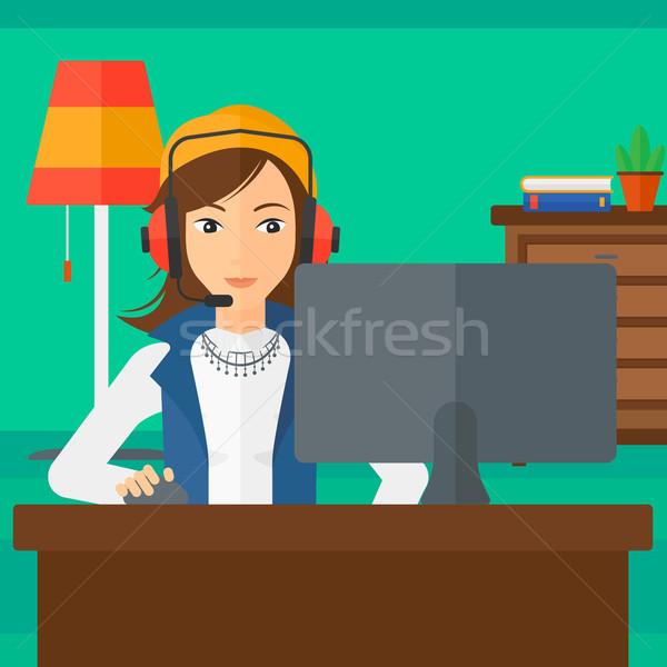 Woman playing video game. Stock photo © RAStudio