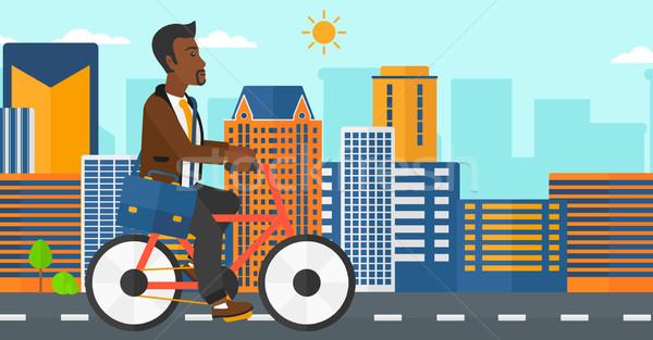 Man cycling to work. Stock photo © RAStudio