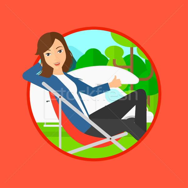 Woman sitting in chair in front of camper van. Stock photo © RAStudio
