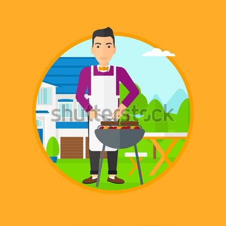 Nő főzés hús benzin barbecue grill ázsiai Stock fotó © RAStudio